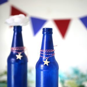 Make your own Red, White & Blue Glass Bottles with this DIY project.