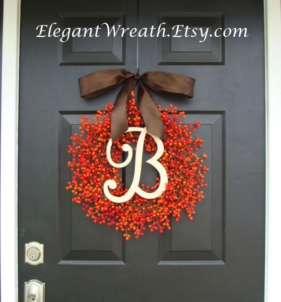 orange berry wreath with monogram VI