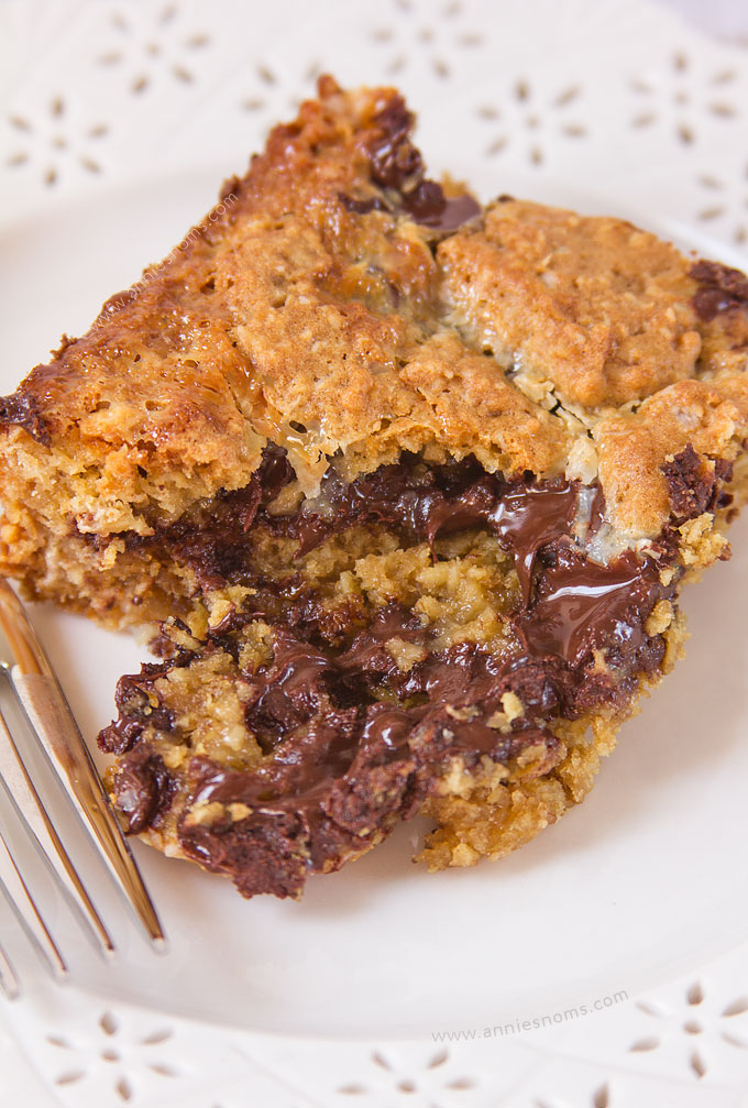 These Chocolate Chip Oatmeal Gooey Bars marry a gooey condensed milk filling, with a soft, oatmeal cookie dough. With plenty of chocolate chips for good measure!