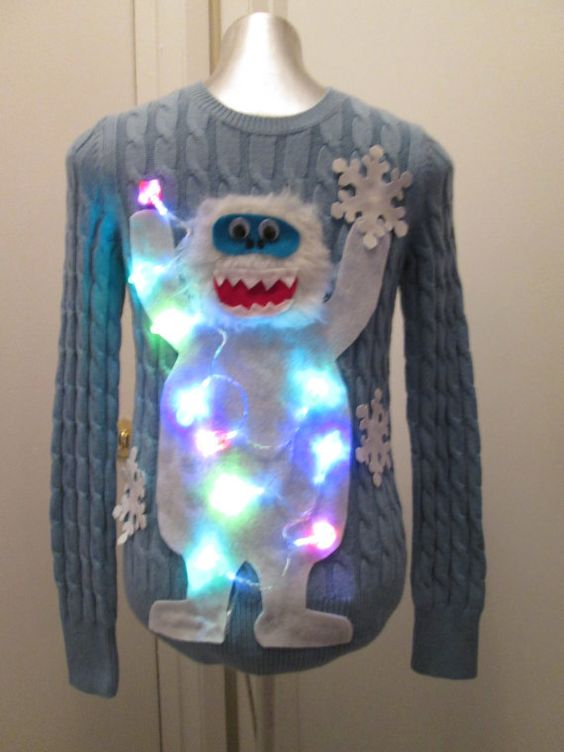 Abominable Snowman Sweater: If you are attending an ugly Christmas sweater party this year, we have got you covered! Here are 25 Ugly Christmas Sweater Ideas for you to use as inspiration.