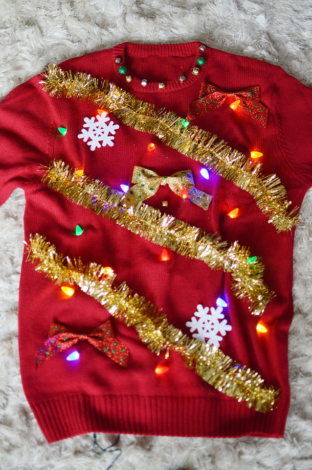 Lights and Tinsel Sweater: If you are attending an ugly Christmas sweater party this year, we have got you covered! Here are 25 Ugly Christmas Sweater Ideas for you to use as inspiration.