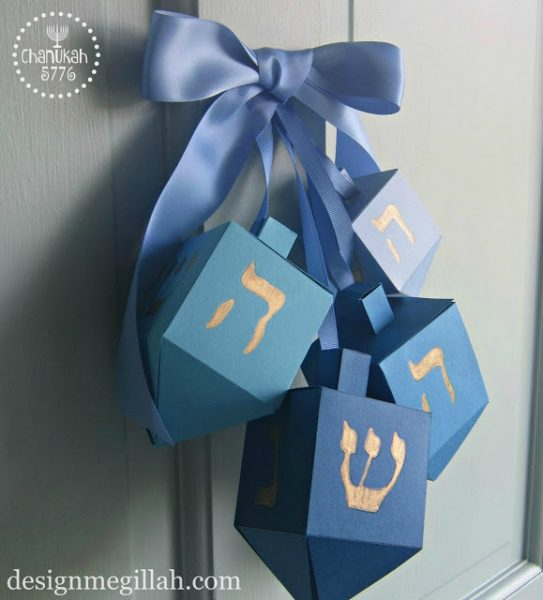 Dreidel Door Hanging: Make your own Hanukkah crafts or get the whole family involved with one of these 10 Hanukkah Crafts