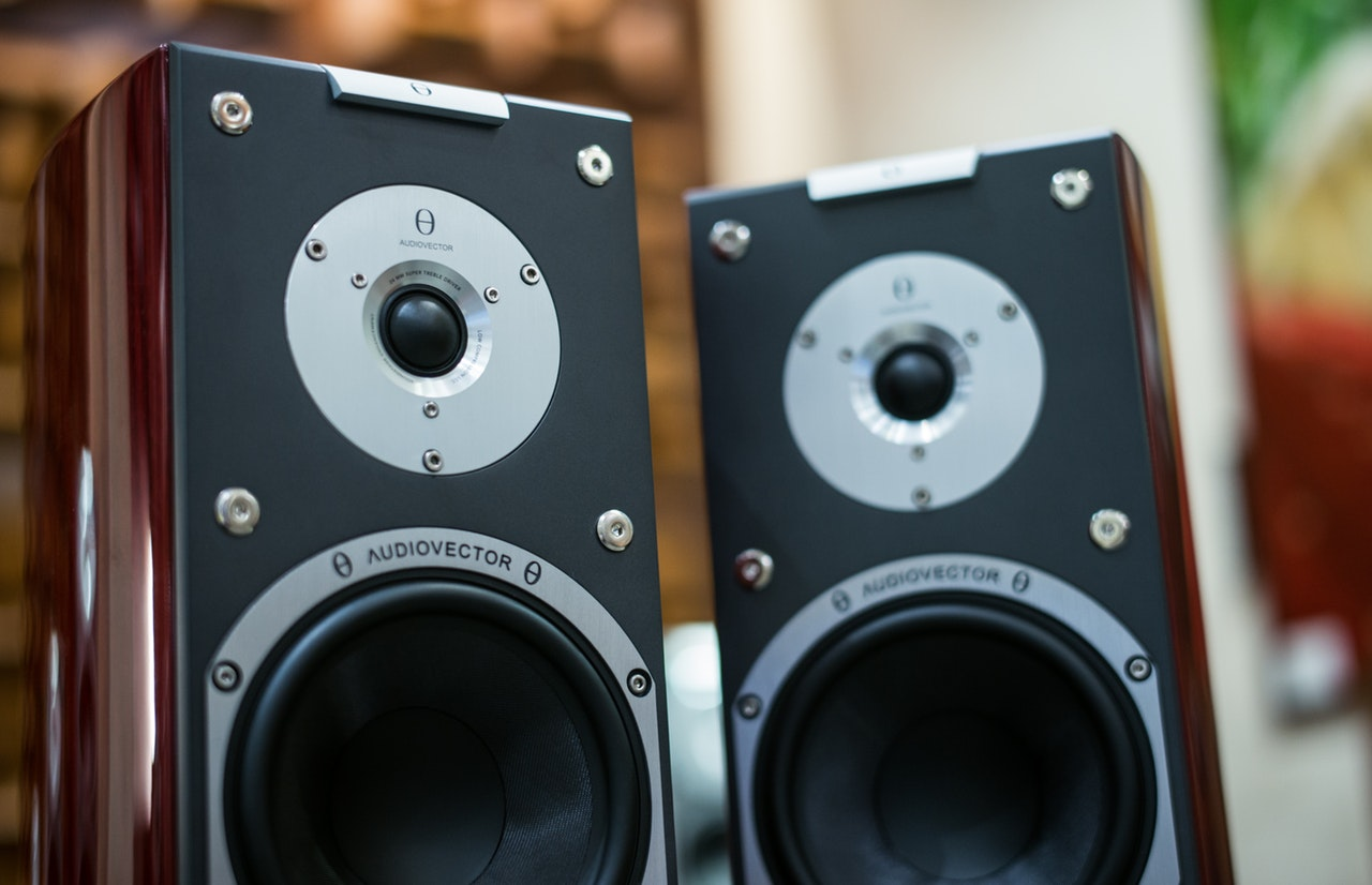 two amplifier speakers side by side