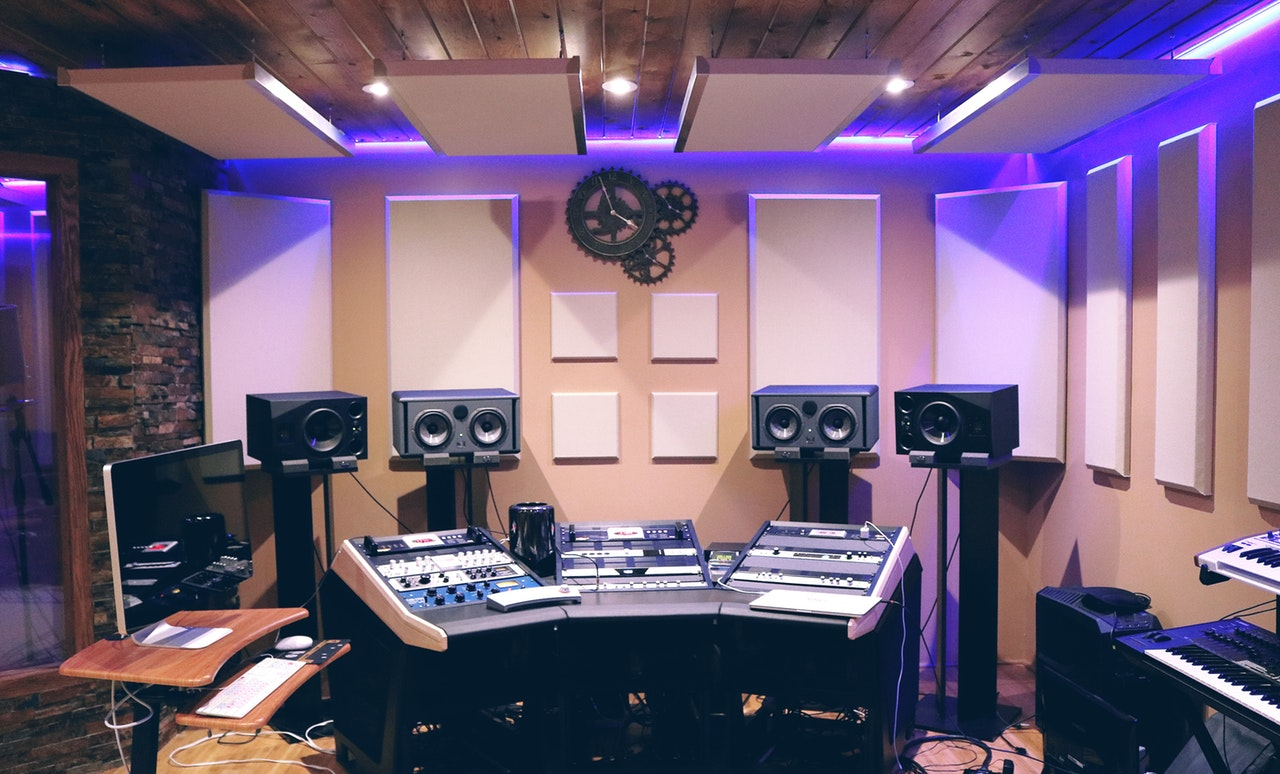 speakers and gadgets set up in recording studio