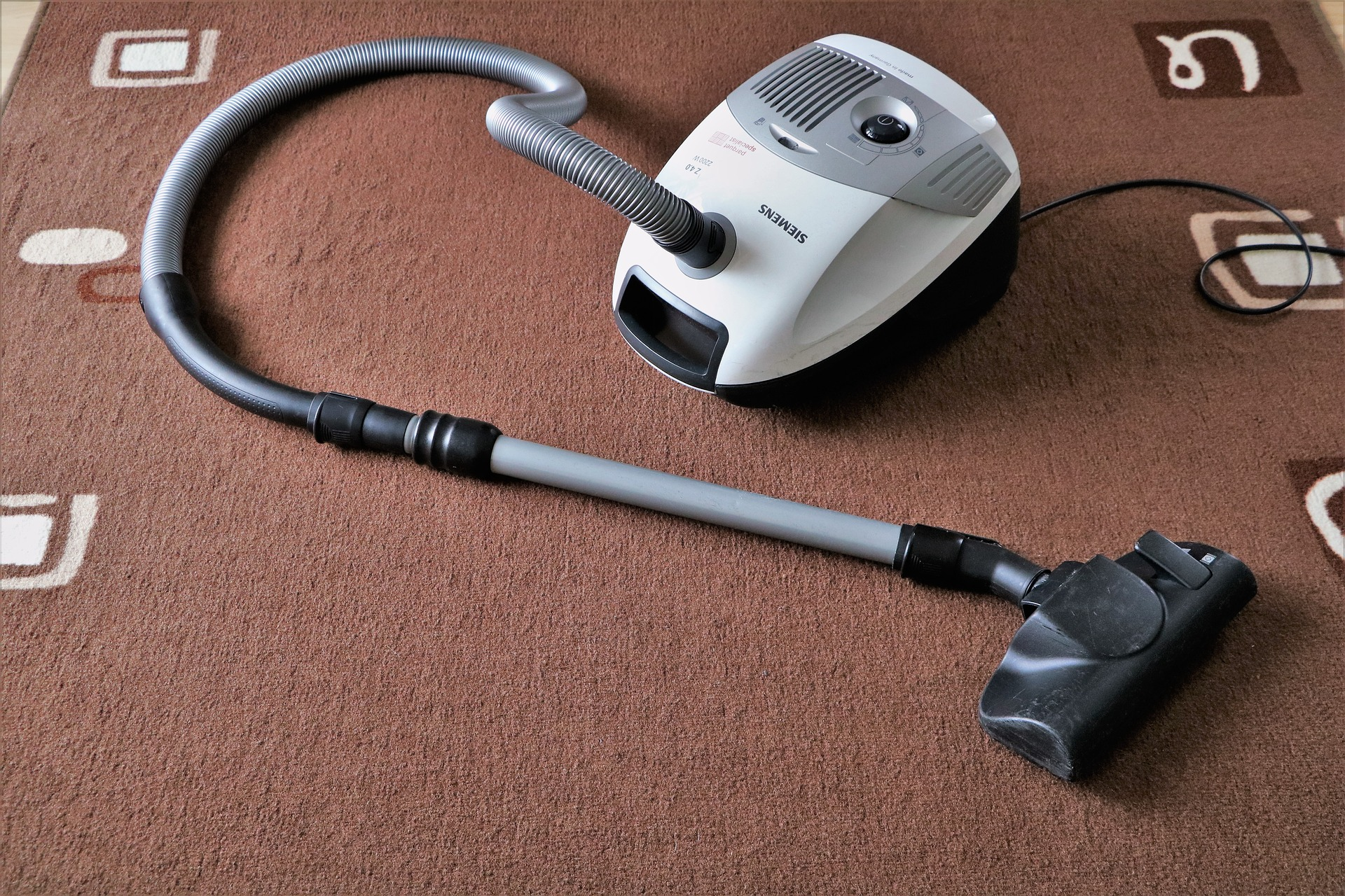 Handheld vacuum in the carpet