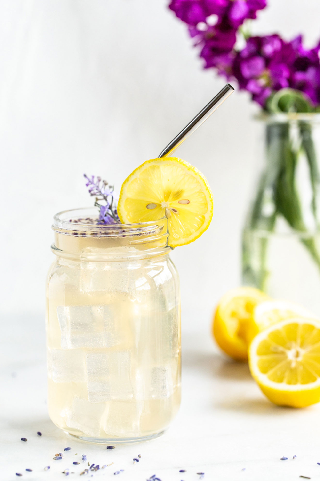 vodka lemonade with lavender and lemons coming out of cup