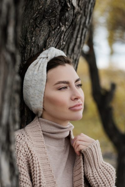 A woman wearing a headband