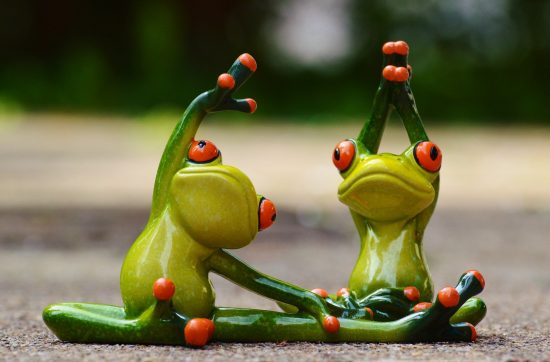 Two frog statues exercising